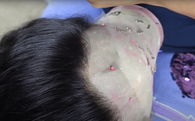 tighten-the-lace-on-the-mannequin-head-with-pins